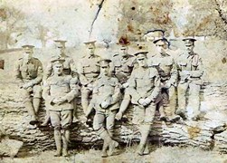 Peter Pieraccini 2nd from rightsitting on log. Bedfordshire Regiment