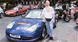 Kevin Jarman in Rome pictured beside the Porsche GT3