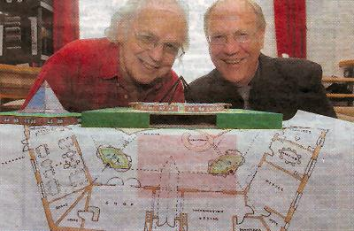 Clive Bevins, right, and Ray Wilson with blueprints for a holistic healing centre in Bedfordshire.