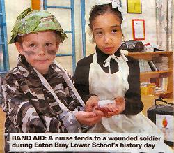 A nurse tends to a wounded soldier during Eaton Bray Lower School's History Day