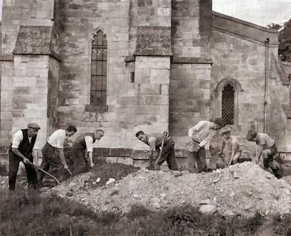 Local parishioners digging drainage ditches